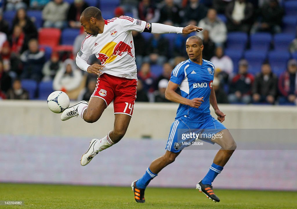 Thierry Henry of the New York Red Bulls plays the ball against Keith Makubuya of the Montreal Impact at Red Bull Arena on March 31 2012 in Harrison...