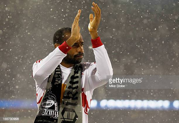 Thierry Henry of the New York Red Bulls salutes the crowd after the match against the DC United was called due to unfavorable weather conditions at...