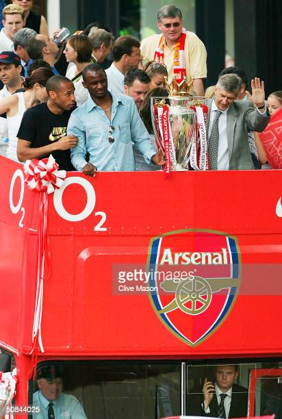 Thierry Henry Patrick Vieira and Arsene Wenger are seen at the front of the bus outside the Islington Town Hall during the Arsenal Football Club...