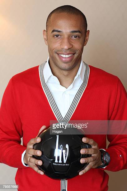 Thierry Henry poses for a photograph as he talks about LIV the charity set up to help find a cure for Cystic Fibrosis on January 25 2008 in Barcelona...