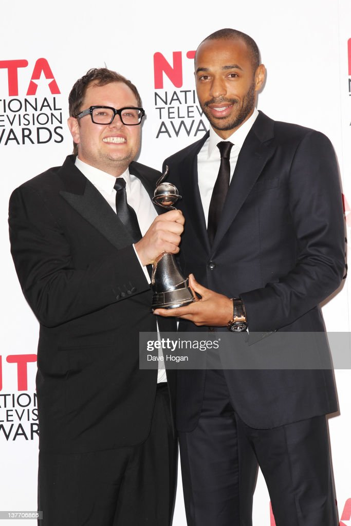 Thierry Henry (R) poses with Alan Carr after presenting him with his Best Talk Show Award in the press room at the National Television Awards 2012 at The O2 Arena on January 25th, 2012 in London, United Kingdom.