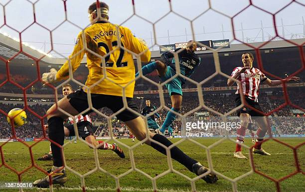 Thierry Henry scores Arsenal's 2nd goal past Simon Mignolet of Sunderland at Stadium of Light on February 11 2012 in Sunderland England