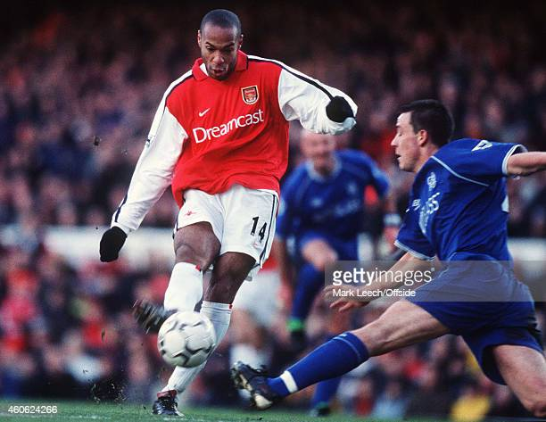 Thierry Henry shoots past John Terry during the Premiership match between Arsenal and Chelsea at the Emirates Stadium on January 13 2001 in London...