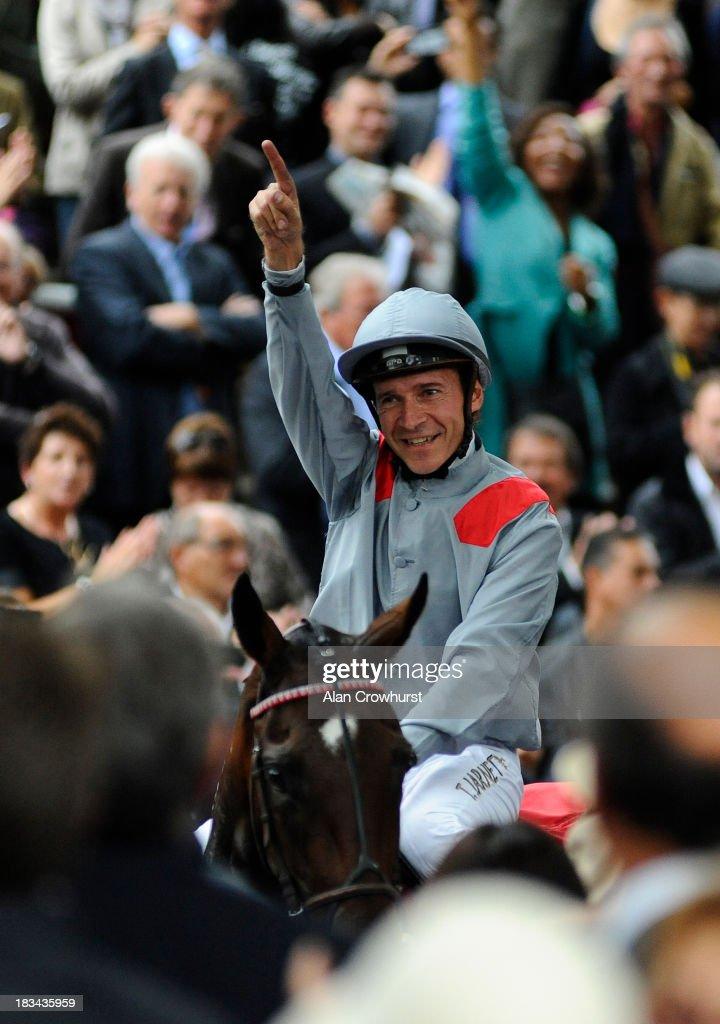 Thierry Jarnet riding Treve celebrates winning The Qatar Prix de l'Arc de Triomphe at Longchamp racecourse on October 06, 2013 in Paris, France.
