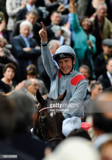 Thierry Jarnet riding Treve celebrates winning The Qatar Prix de l'Arc de Triomphe at Longchamp racecourse on October 06 2013 in Paris France