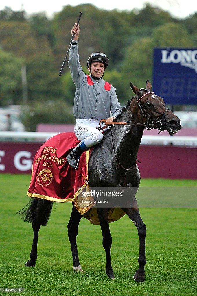 Thierry Jarnet riding Treve celebrates winning The Qatar Prix de l'Arc de Triomphe at Hippodrome de Longchamp on October 6, 2013 in Paris, France.