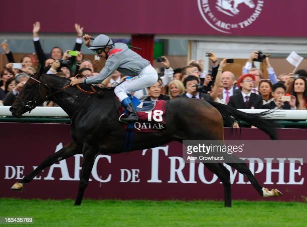 Thierry Jarnet riding Treve win The Qatar Prix de l'Arc de Triomphe at Longchamp racecourse on October 06 2013 in Paris France