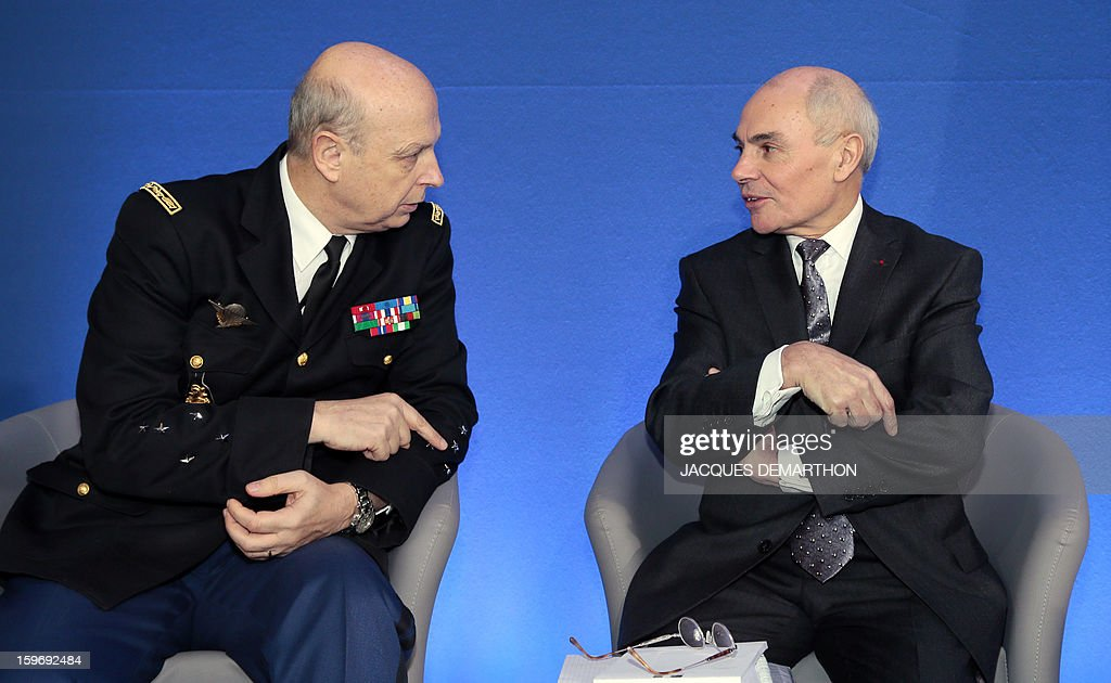 Thierry Lataste, chief of staff of French Interior minister (R) speaks with Jacques Mignaux (L) general director of the gendarmerie nationale during the presentation of the report of the past year and the prospects of the security policy for the upcoming yearon January 18, 2013 at the ministry in Paris.