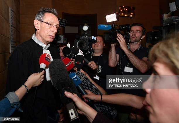 Thierry Moser lawyer of Alexandre Beckrich's father speaks to journalists on May 17 2017 at the Assize Court of Moselle in Metz eastern France...