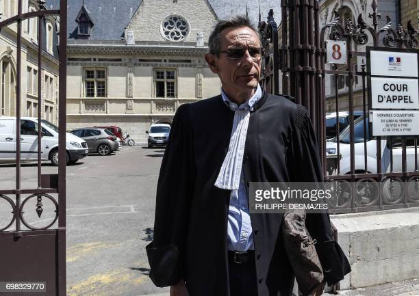 Thierry Moser lawyer of Gregory's parents answers journalists' questions upon his arrival at Dijon's courthouse on June 20 prior to a hearing as part...