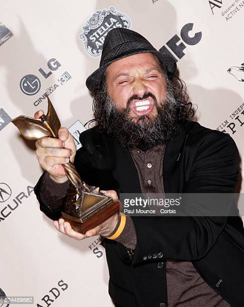 Thierry 'Mr Brainwash' Guetta poses with the award won by the artist Bansky for Best Documentary in the press room at the 26th Annual Film...
