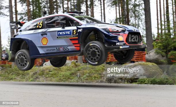 Thierry Neuville from Belgium and his codriver Nicolas Klinger steer their Hyundai during the stage Ruuhimäki shakedown of the Neste Rally Finland in...