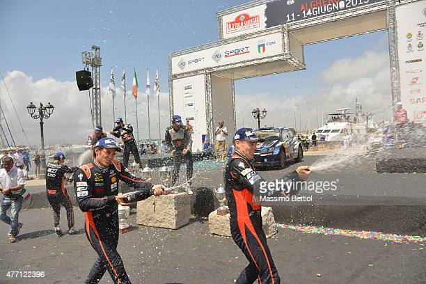 Thierry Neuville of Belgium and Hayden Paddon of New Zealand celebrate their final podium during Day Three of the WRC Italy on June 14 2015 in...