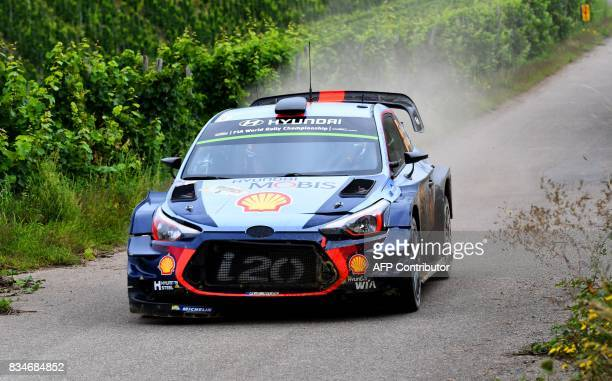 Thierry Neuville of Belgium and his codriver Nicolas Gilsoul of Belgium steer their Hyundai WRC car during stage 3 of the Rally Germany in Klueserath...