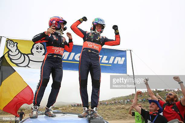 Thierry Neuville of Belgium and Nicolas Gilsoul of Belgium celebrate their victory during Day Three of the WRC Italy Sardegna on June 12 2016 in...