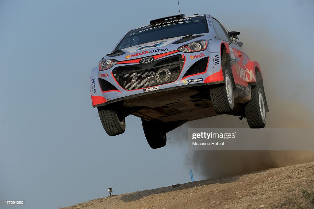 <a gi-track='captionPersonalityLinkClicked' href=/galleries/search?phrase=Thierry+Neuville&family=editorial&specificpeople=8627679 ng-click='$event.stopPropagation()'>Thierry Neuville</a> of Belgium and Nicolas Gilsoul of Belgium compete in their Hyundai Motorsport Hyundai i20 WRC during Day Two of the WRC Italy on June 13, 2015 in Alghero, Italy.
