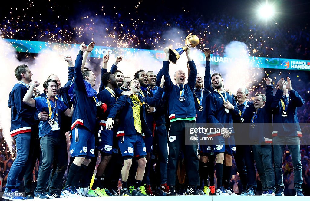 Thierry Omeyer of France lifts the trophy as he celebrates victory with team mates during the 25th IHF Men's World Championship 2017 Final between France and Norway at Accorhotels Arena on January 29, 2017 in Paris, France.