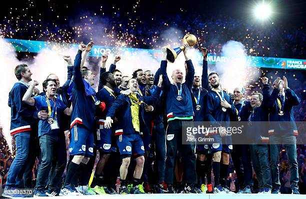Thierry Omeyer of France lifts the trophy as he celebrates victory with team mates during the 25th IHF Men's World Championship 2017 Final between...