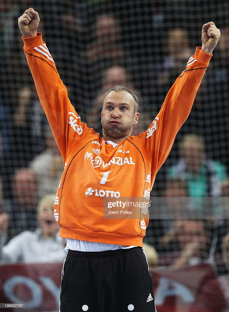 <a gi-track='captionPersonalityLinkClicked' href=/galleries/search?phrase=Thierry+Omeyer&family=editorial&specificpeople=853674 ng-click='$event.stopPropagation()'>Thierry Omeyer</a> of Kiel celebrates during the Toyota Handball Bundesliga match between THW Kiel and HSV Hamburg at the Sparkassen Arena on December 11, 2011 in Flensburg, Germany.