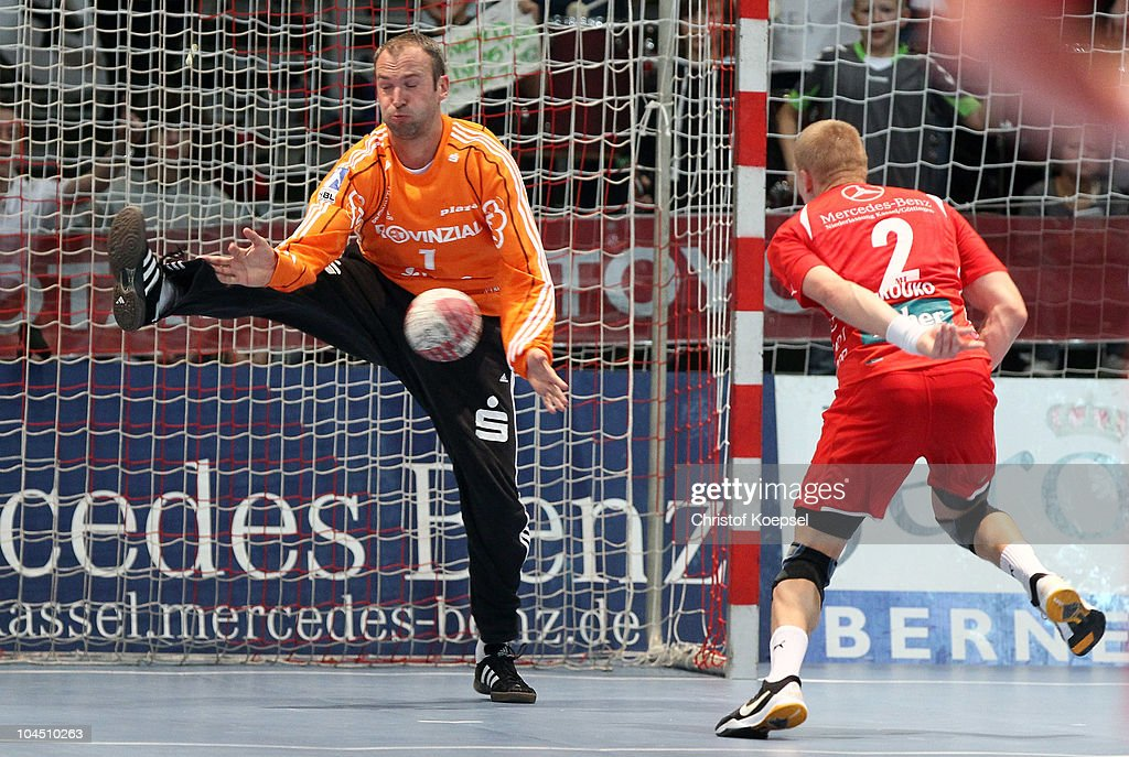 <a gi-track='captionPersonalityLinkClicked' href=/galleries/search?phrase=Thierry+Omeyer&family=editorial&specificpeople=853674 ng-click='$event.stopPropagation()'>Thierry Omeyer</a> of Kiel (L) saves a shot of Ivan Brovko of Melsungen (R) during the Toyota Handball Bundesliga match between MT Melsungen and THW Kiel at the Rotehnbach Hall on September 28, 2010 in Kassel, Germany.