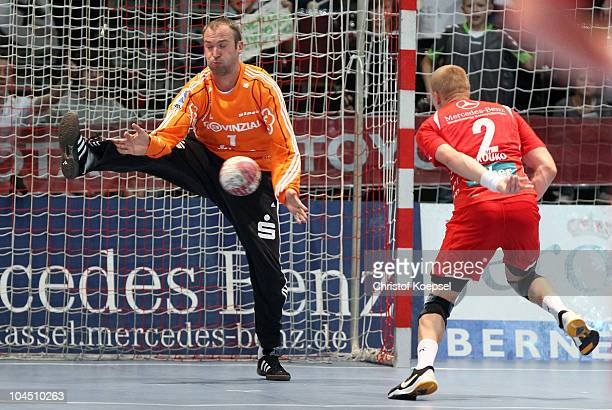 Thierry Omeyer of Kiel saves a shot of Ivan Brovko of Melsungen during the Toyota Handball Bundesliga match between MT Melsungen and THW Kiel at the...