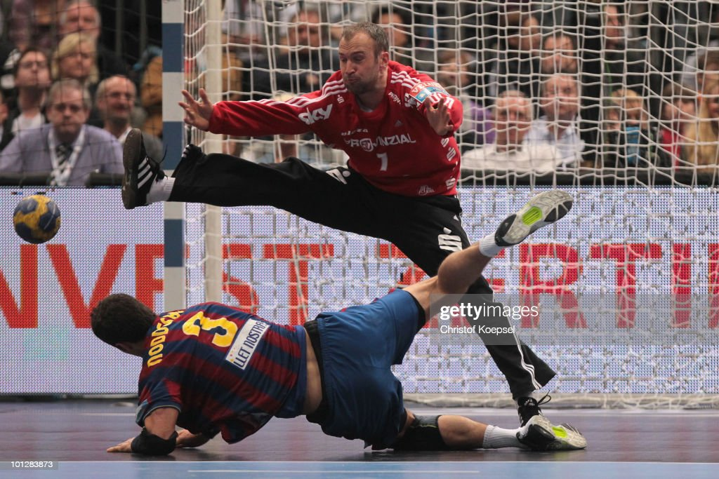 <a gi-track='captionPersonalityLinkClicked' href=/galleries/search?phrase=Thierry+Omeyer&family=editorial&specificpeople=853674 ng-click='$event.stopPropagation()'>Thierry Omeyer</a> of Kiel saves a shot of Jesper Brian Noeddesbo of Barcelona Borges during the handball final match between THW Kiel and FC Barcelona Borges at the Lanxess Arena on May 30 in Cologne, Germany.