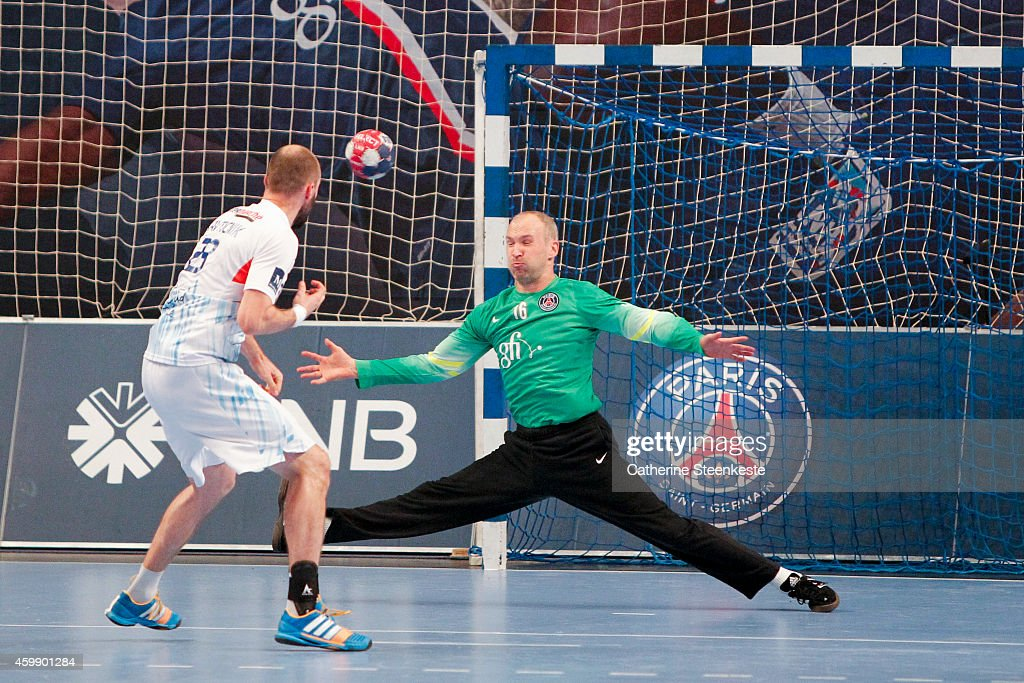 Thierry Omeyer of PSG makes a stop on the ball against Vid Kavticnik of Montpellier Agglomeration Handball during the game between PSG Handball and...