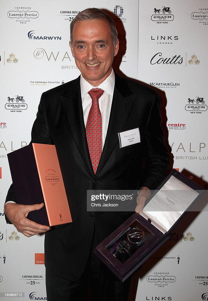 Thierry Outin of Hermes poses with the International Luxury Brand Award at the Walpole Awards of Excellence 2011 at Banqueting House on November 14, 2011 in London, England.
