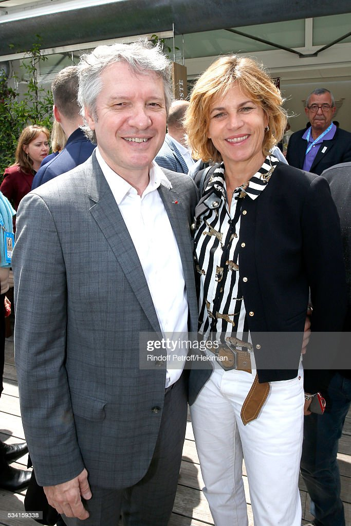 Thierry Rey and Virginie Couperie-Eiffel attend the 2016 French Tennis Open - Day Four at Roland Garros on May 25, 2016 in Paris, France.