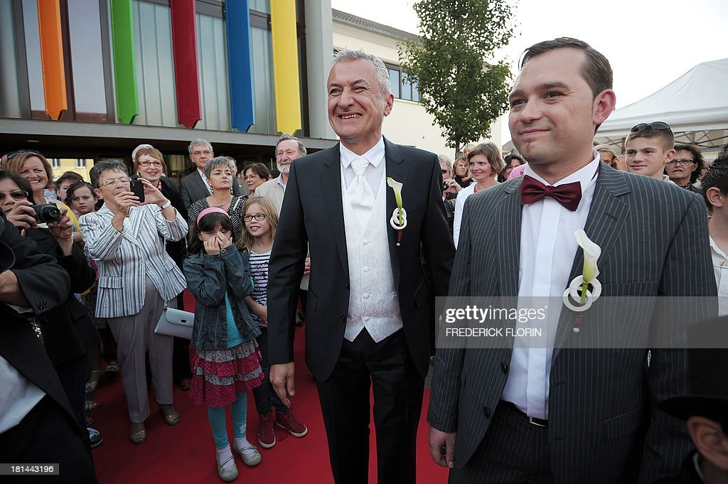 Thierry Speitel (R) and Alexandre Gotz celebrate during their wedding ceremony at the city hall of Sigolsheim, eastern France, on September 21, 2013. Thierry Speitel, mayor of Sigolsheim, eastern France, who lodged a complaint on May 2 after receiving a letter containing two cartridges, taped to an article of a the Dernieres nouvelles d'Alsace (DNA) newspaper in which he talked about his homosexuality. AFP PHOTO/FREDERICK FLORIN