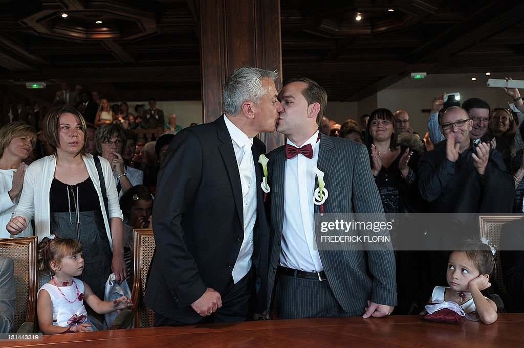 Thierry Speitel (L) and Alexandre Gotz kiss during their wedding ceremony at the city hall of Sigolsheim, eastern France, on September 21, 2013. Thierry Speitel, mayor of Sigolsheim, eastern France, who lodged a complaint on May 2 after receiving a letter containing two cartridges, taped to an article of a the Dernieres nouvelles d'Alsace (DNA) newspaper in which he talked about his homosexuality.