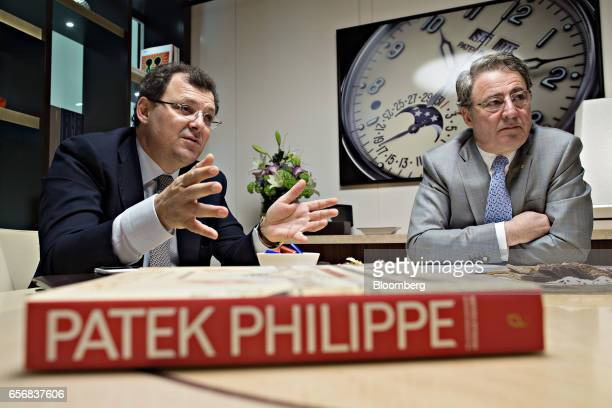Thierry Stern chairman of Patek Philippe SA left gestures as he speaks while Claude Peny chief executive officer of of Patek Philippe SA listens...