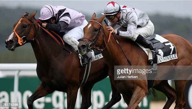 Thierry Thulliez ridden Satwa Queen gets the better of the Jimmy Fortune ridden Bahia Breeze to land The Prix Jean Romanet Race run at Deauville...