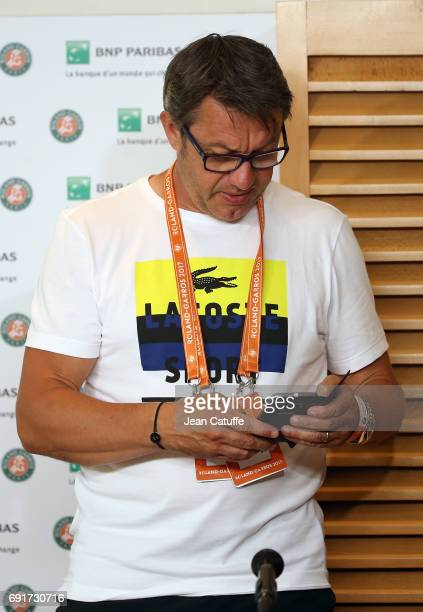 Thierry Van Cleemput coach of David Goffin of Belgium answers to the media following his player's injury on day 6 of the 2017 French Open second...
