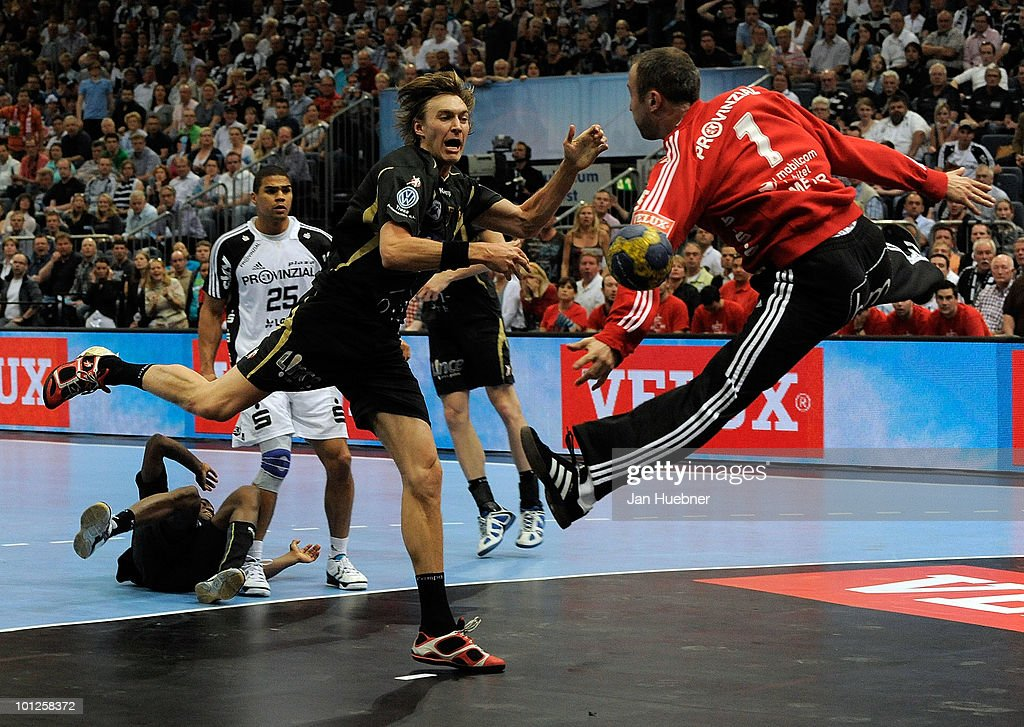 Thiery Omeyer (R) of THW Kiel defend against Jonas Kallman of Ciudad Real during the handball semi final match between Ciudad Real and THW Kiel on May 29 in Cologne, Germany.