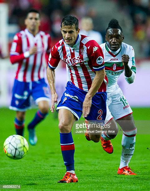 Thievy Bifouma of Granada CF duels for the ball with Luis Hernandez of Real Sporting de Gijon during the La Liga match between Real Sporting de Gijon...