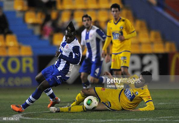 Thievy Guivane Bifouma of Espanyol battles for the ball against Jose Manuel alias ÔChemaÕ of AD Alcorcon during the Copa del Rey Round of 16 1st leg...