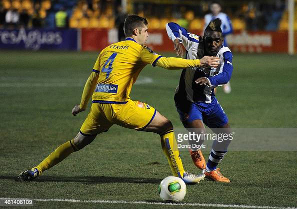 Thievy Guivane Bifouma of Espanyol battles for the ball against Hector Verdes of AD Alcorcon during the Copa del Rey Round of 16 1st leg match...