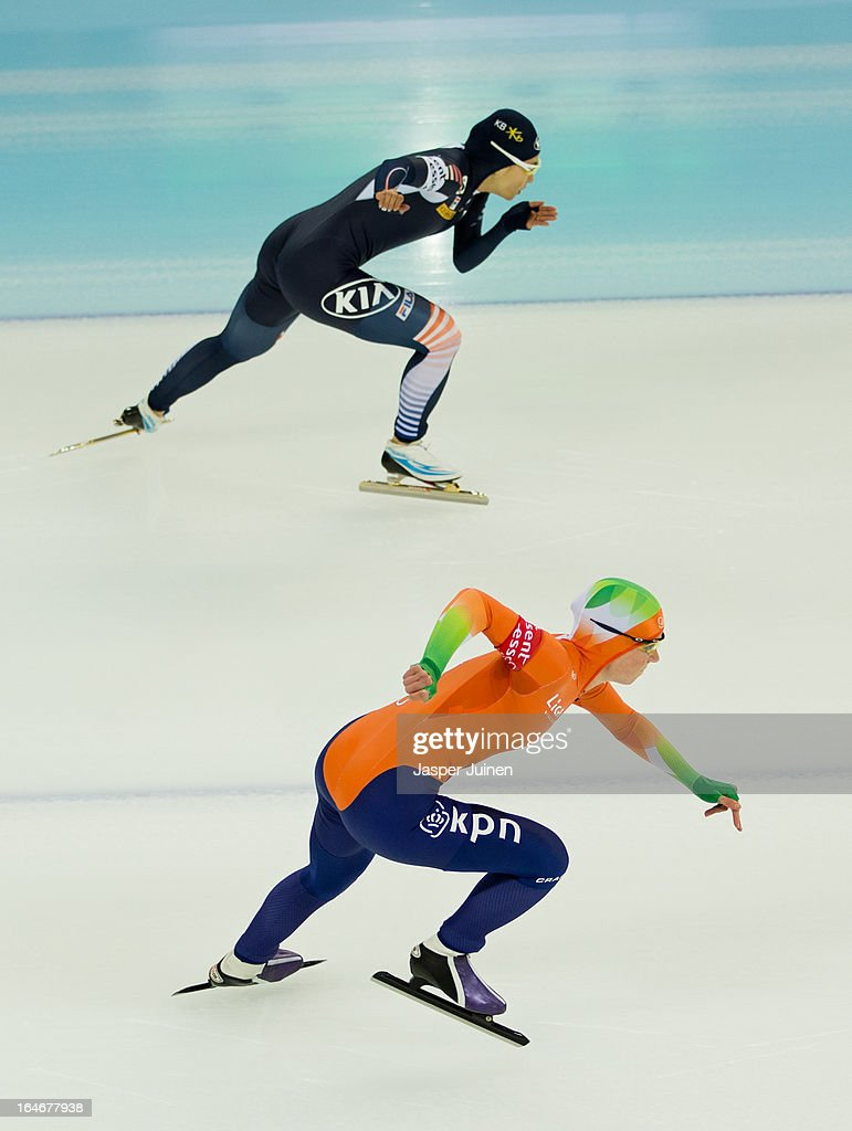 Thijsje Oenema (L) of the Netherlands competes against Sang-Hwa Lee of Korea during the 500m race on day four of the Essent ISU World Single Distances Speed Skating Championships at the Adler Arena Skating Center on March 24, 2013 in Sochi, Russia.