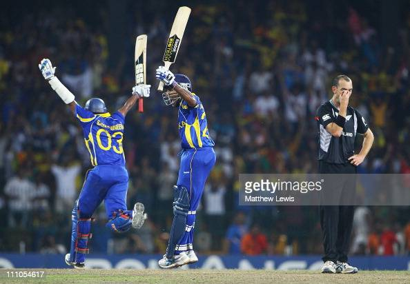 Thilan Samaraweera and Mahela Jayawardena of Sri Lanka celebrate their teams win as Andy McKay of New Zealand looks on during the 2011 ICC World Cup...