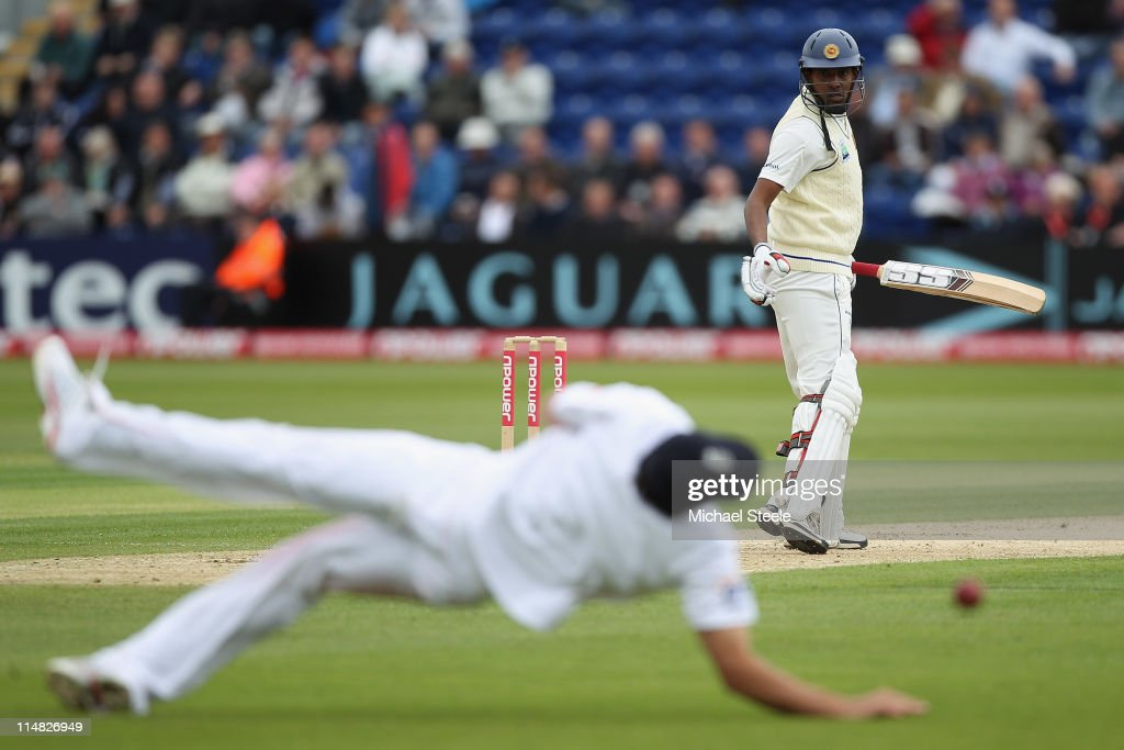 Thilan Samaraweera of Sri Lanka looks back anxiously as Alastair Cook narrowly fails to take the catch off the bowling of Chris Tremlett during day...