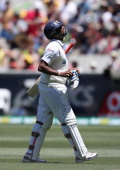 Thilan Samaraweera of Sri Lanka walks back after being bowled by Peter Siddle during day one of the Second Test match between Australia and Sri Lanka...