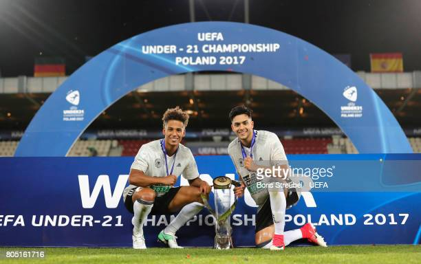 Thilo Kehrer and Nadiem Amiri of Germany celebrate with the trophy after winning the UEFA European Under21 Championship Final match between Germany...