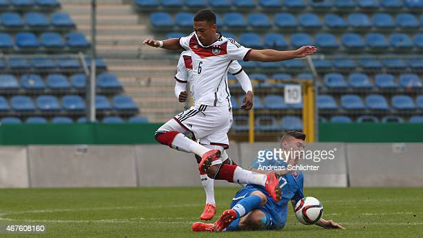 Thilo Kehrer of Germany challenges Lukas Haraslin of Slovakia during the UEFA Under19 Elite Round match between U19 Germany and U19 Slovakia at...
