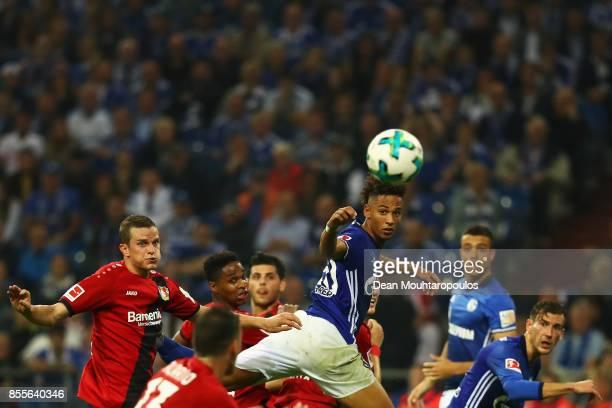 Thilo Kehrer of Schalke 04 and Lars Bender of Bayer 04 Leverkusen battle for the ball during the Bundesliga match between FC Schalke 04 and Bayer 04...