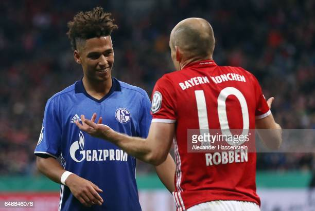 Thilo Kehrer of Schalke and Arjen Robben of Muenchen discuss during the DFB Cup quarter final between Bayern Muenchen and FC Schalke 04 at Allianz...