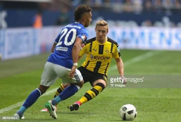 Thilo Kehrer of Schalke and Felix Passlack of Dortmund battle for the ball during the Bundesliga match between FC Schalke 04 and Borussia Dortmund at...