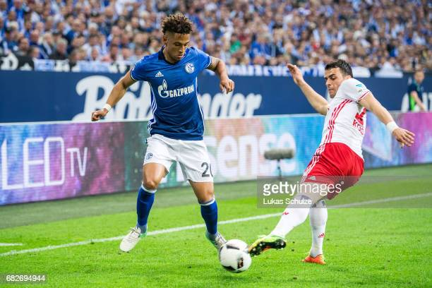 Thilo Kehrer of Schalke and Filip Kostic of Hamburg fight for the ball during the Bundesliga match between FC Schalke 04 and Hamburger SV at...