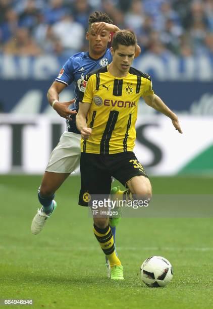 Thilo Kehrer of Schalke and Julian Weigl of Dortmund controls the ball during the Bundesliga match between FC Schalke 04 and Borussia Dortmund at...