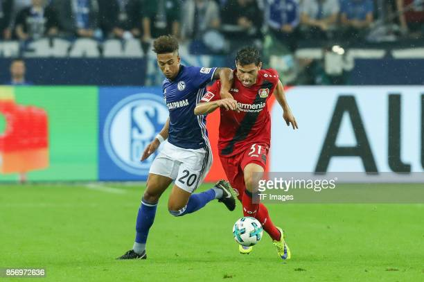Thilo Kehrer of Schalke and Kevin Volland of Leverkusen battle for the ball during the Bundesliga match between FC Schalke 04 and Bayer 04 Leverkusen...